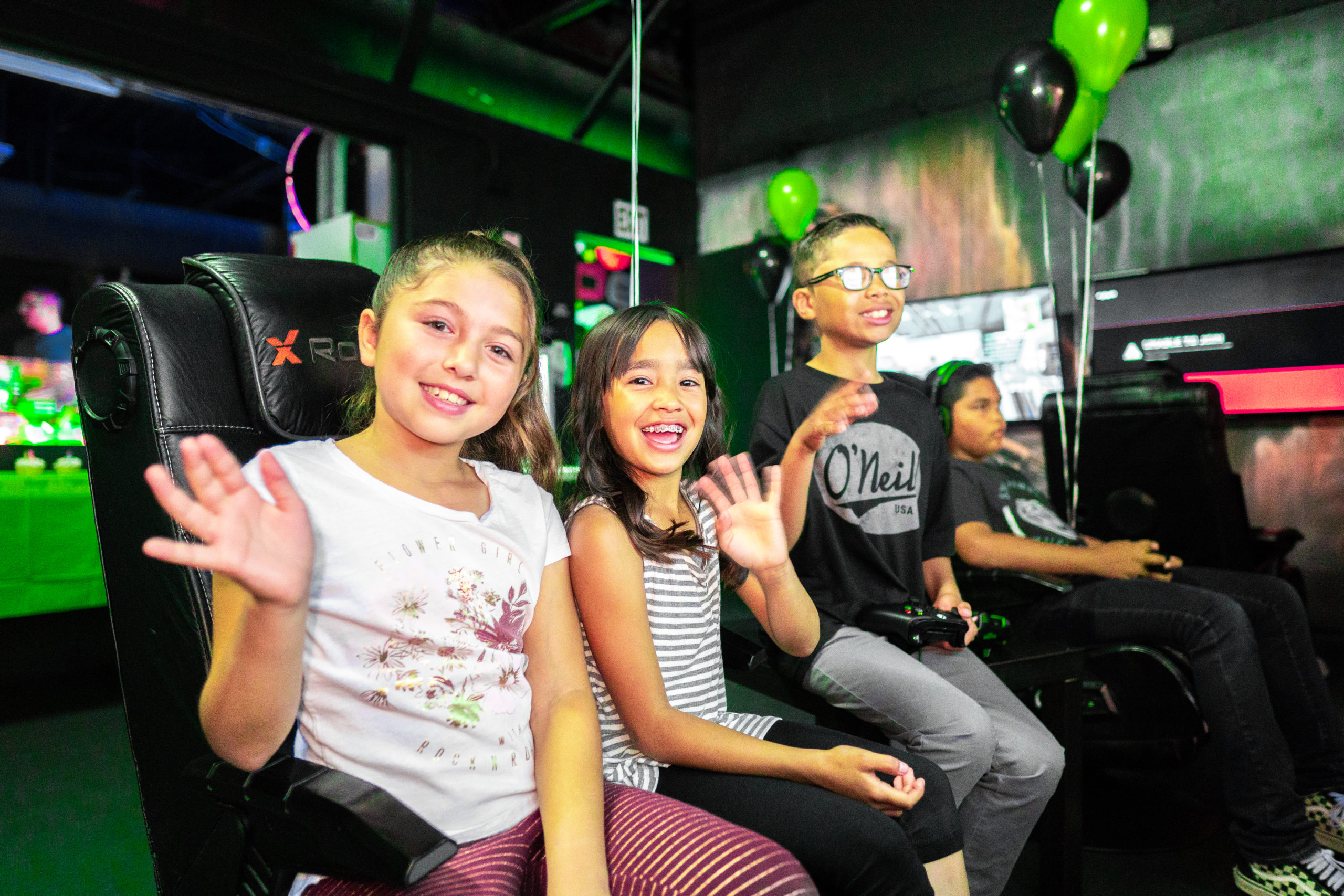 Kids Enjoying Xbox Gaming - Glo Mini Golf, Riverside, CA
